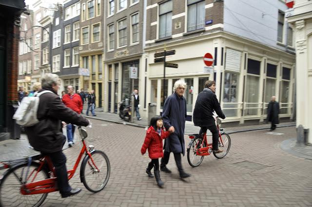 Walking inbetween bikes in Amsterdam